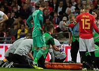 Football - 2018 / 2019 UEFA Nations League A - Group Four: England vs. Spain<br /> <br /> David de Gea (Spain) checks on club team mate Luke Shaw (England) as medical staff prepare a neckbrace at Wembley Stadium.<br /> <br /> COLORSPORT/DANIEL BEARHAM