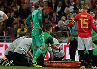 Football - 2018 / 2019 UEFA Nations League A - Group Four: England vs. Spain<br /> <br /> David de Gea (Spain) checks on club team mate Luke Shaw (England) as medical staff prepare a neckbrace at Wembley Stadium.<br /> <br /> COLORSPORT/DANIEL BEARHAM