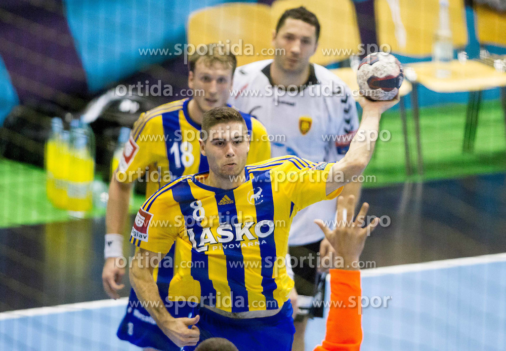 Blaz Janc of Celje PL during handball match between RK Celje Pivovarna Lasko and HC Vardar Skopje (MKD) in 1st Round of Group C of EHF Champions League 2014/15, on September 27, 2014 in Arena Zlatorog, Celje, Slovenia. Photo by Vid Ponikvar / Sportida.com
