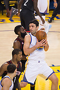 Golden State Warriors center Zaza Pachulia (27) takes the ball to the basket against Houston Rockets guard James Harden (13) at Oracle Arena in Oakland, Calif., on March 31, 2017. (Stan Olszewski/Special to S.F. Examiner)