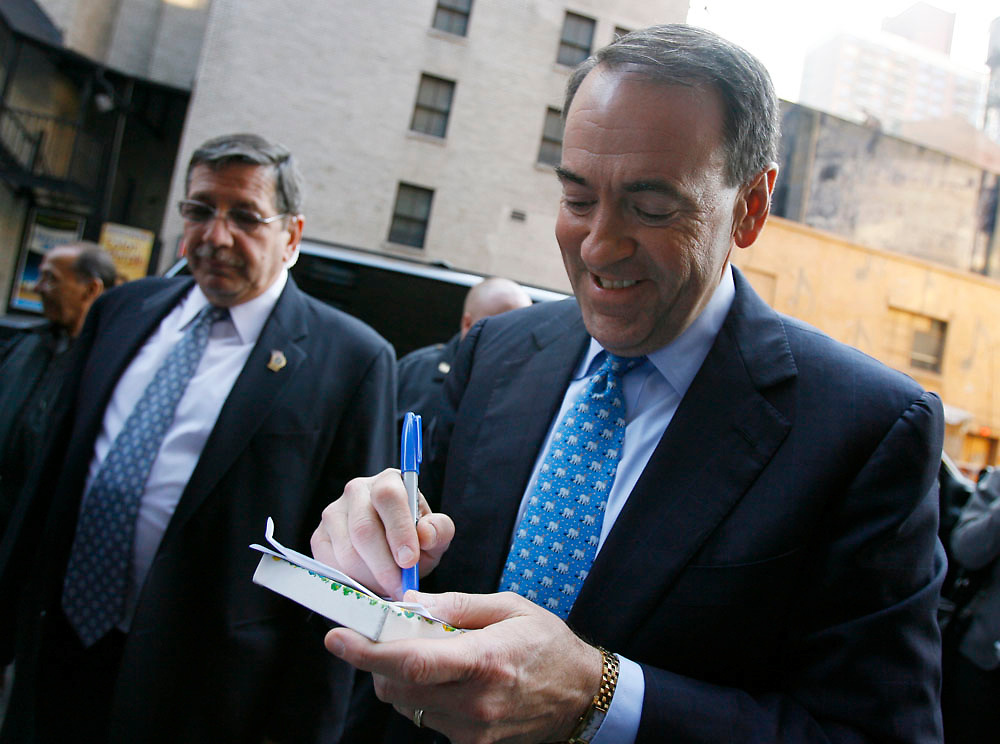 Presidential candidate Mike Huckabee signs autographs before taping the Late Show With David Letterman