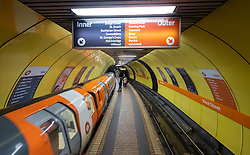 View of platform and train inside station on the Glasgow Subway system in Glasgow, Scotland UK