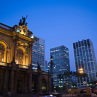 Teatro Municipal and office buildings illuminated at dusk, Sao Paulo, Brazil