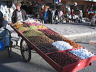 A Tibetan man selling dried fruit in Lhasa
