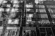 New York - saint patrick cathedral , reflected on a mirror tower,  of fifth avenue.  New York, Manhattan - United states / la cathedrale saint patrick, jeu de mirroir sur un building, 5 em avenue. Manhattan, New York - Etats unis