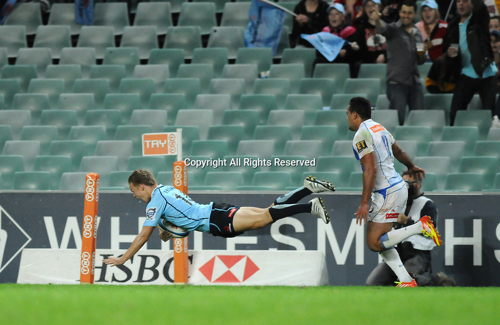 17.03.2012 Sydney, Australia. Waratahs winger Tom Kingston scores a try during the FxPro Super Rugby game between the New South Wales Waratahs  and Western Force at the Allianz Stadium,Sydney.