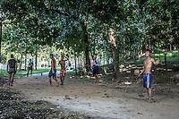 Locals playing football in the grounds of Kandawgyi Lake, Yangon, Burma.