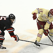 Ryan Fitzgerald #19 of the Boston College Eagles keeps the puck from Kevin Roy #15 of the Northeastern Huskies during The Beanpot Championship Game at TD Garden on February 10, 2014 in Boston, Massachusetts. (Photo by Elan Kawesch)