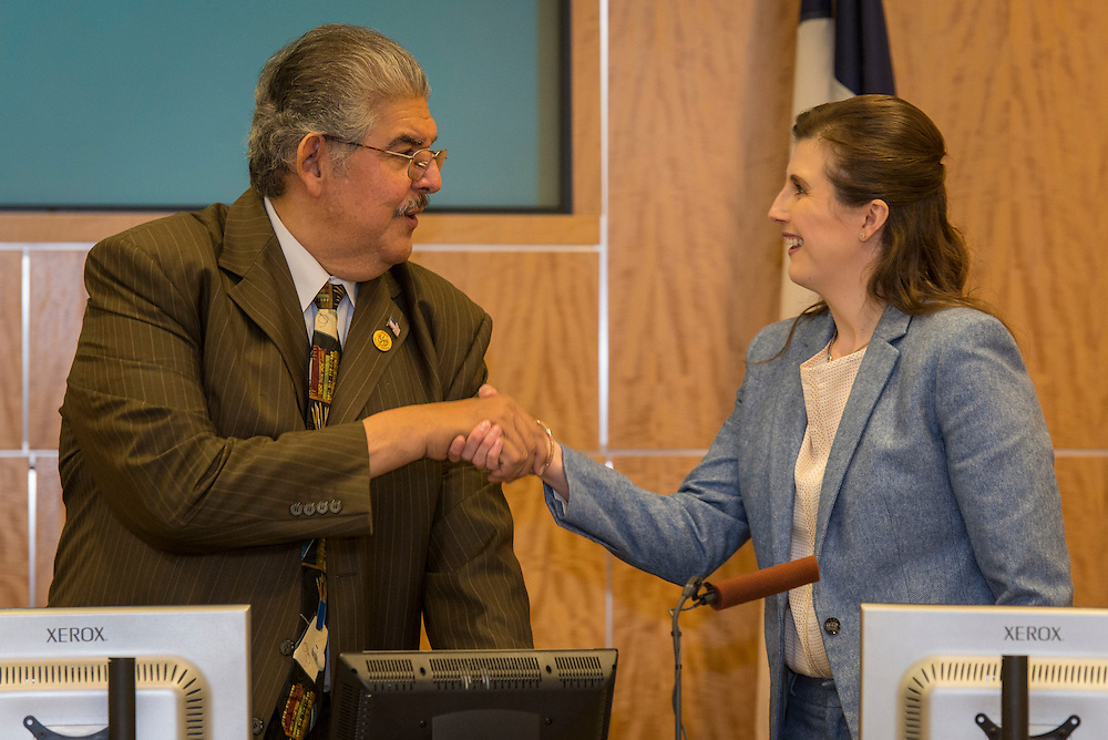 Holly Maria Flynn Vilaseca Ocampo is welcomed to the Board by President Manuel Rodriguez after taking the oath of office to become Houston ISD Trustee for District VI, January 12, 2017.