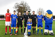 The captains match officials and match day mascots have their photo taken ahead of the EFL Sky Bet League 1 match between AFC Wimbledon and Fleetwood Town at the Cherry Red Records Stadium, Kingston, England on 30 March 2018. Picture by Stephen Wright.