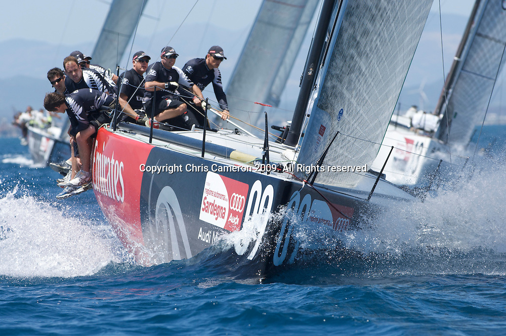 Emirates Team New Zealand TP52 NZL380 leads the fleet at the first mark in race one, day one, Sardinia Trophy, Audi MedCup 21/7/2009