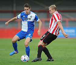 Tom Lockyer of Bristol Rovers closes down Danny Wright of Cheltenham Town - Mandatory by-line: Dougie Allward/JMP - 25/07/2015 - SPORT - FOOTBALL - Cheltenham Town,England - Whaddon Road - Cheltenham Town v Bristol Rovers - Pre-Season Friendly