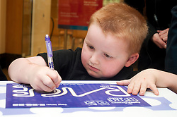 "Cadburys Spots vs Stripes Challenge Race Season Meadowhall Sheffield.Thomas Tilbrook takes part in the ""fastest doodler"".2 April 2011.Images © Paul David Drabble"