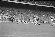 Players falls after a tackle for the ball during the All Ireland Senior Gaelic Football Championship Final Kerry v Dublin at Croke Park on the 22nd September 1985. Kerry 2-12 Dublin 2-08.