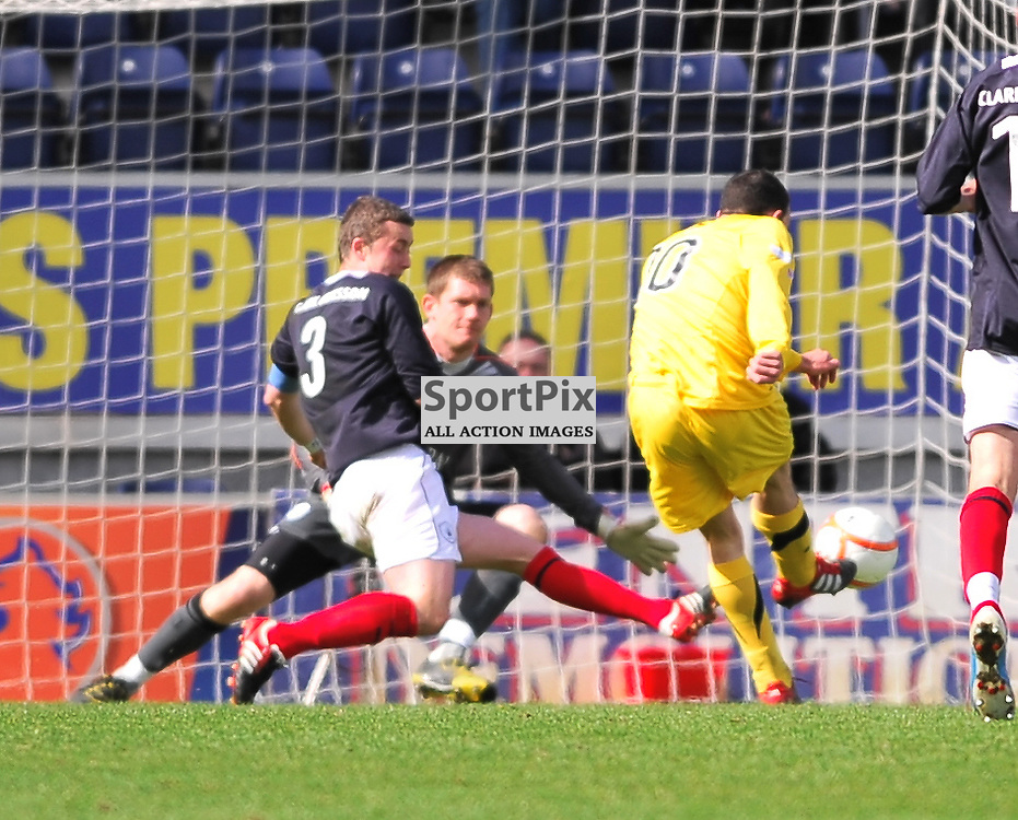 Michael Moffat (Ayr, yellow, 10) scores the equaliser..Falkirk v Ayr, SFL 1st Division, Saturday 5th May 2012..ALEX TODD | STOCKPIX.EU