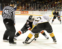 Shayne Wiebe of the Brandon Wheat Kings and Jimmy Bubnick of the Calgary Hitmen faceoff in Game 6 of the 2010 MasterCard Memorial Cup in Brandon, MB on Wednesday May 19, 2010. Photo by Aaron Bell/CHL Images
