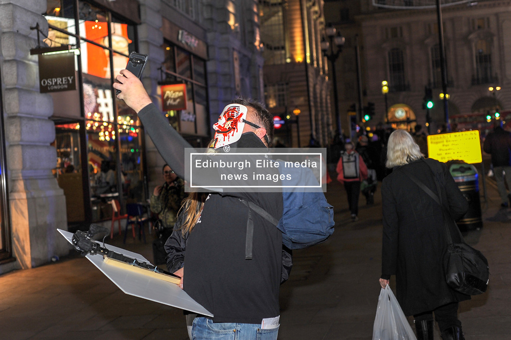 Protesters take selfies during the annual 'Million Mask March' demonstration. London, 05 November 2018.