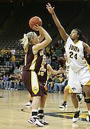25 JANUARY 2007: Minnesota guard Emily Fox (4) puts a shot up in front of Iowa forward Jenee Graham (24) in Iowa's 80-78 overtime loss to Minnesota at Carver-Hawkeye Arena in Iowa City, Iowa on January 25, 2007.