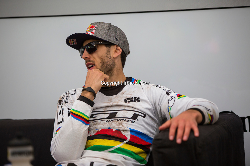 Gee Atherton rests his hand after a crash in his qualification run at the Lourdes World Cup downhill.