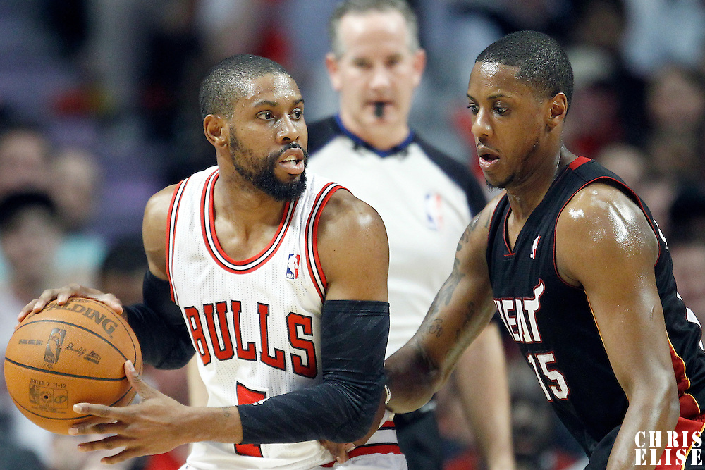 14 March 2012: Miami Heat point guard Mario Chalmers (15) defends on Chicago Bulls point guard C.J. Watson (7) during the Chicago Bulls 106-102 victory over the Miami Heat at the United Center, Chicago, Illinois, USA.