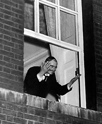 Neville Chamberlain waves to crowds from the window of No.10 after the Munich Agreement was signed.