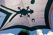 Flag hung for shade over courtyard in Nagore Aandagai Dargah Shareef.