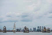 The Loth Lorien passes the Thames Barrier - Royal Greenwich Tall Ships Festival with a fleet of square rigged ships moored on the Thames at Greenwich and Woolwich. The fleet includes two of the biggest Class A Tall Ships - the Dar Mlodziezy and Santa Maria Manuela - which are moored on Tall Ships Island in the river off Greenwich. Tall Ships Festival Day on Saturday 29 August featured free family entertainment and the chance to enjoy a taste of life on the high seas.