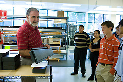 Joe Minahan, Operations Manager at INOVA Solutions, shows students from Albemarle High School one of the LED displays that his company manufactures.  Students toured INOVA Solutions in downtown Charlottesville, VA as part of Charlottesville TechTour 2008 on October 9, 2008.  (Special to the Daily Progress / Jason O. Watson)