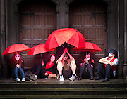 performers wait in the rain before their act in the edinburgh festival in Scotland