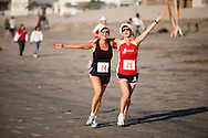 Deb Sims and Sandy Guy-Willoughby participate in the Red Nose Run.