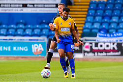 Jacob Mellis of Mansfield Town holds off pressure from Frankie Kent of Colchester United - Mandatory by-line: Ryan Crockett/JMP - 18/08/2018 - FOOTBALL - One Call Stadium - Mansfield, England - Mansfield Town v Colchester United - Sky Bet League Two