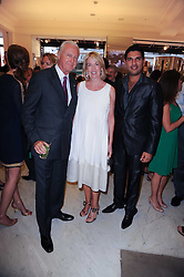 Left to right, GALEN & HILARY WESTON and Indian cricket star YUVRAJ SINGH at Emerald for Elephants exhibition held at Selfridge's, Oxford Street, London on 23rd June 2010.