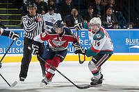 KELOWNA, CANADA - MARCH 22: Rourke Chartier #14 of the Kelowna Rockets checks Parker Bowles #39 of the Tri-City Americans off the face off on March 22, 2014 during game 1 of the first round of WHL Playoffs at Prospera Place in Kelowna, British Columbia, Canada.   (Photo by Marissa Baecker/Getty Images)  *** Local Caption *** Rourke Chartier; Parker Bowles;