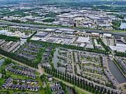 Nederland, Utrecht, Utrecht; 14–05-2020; stadsdeel Leidsche Rijn, de wijk Terwijde, Rijnkennemerlaan-Noord, in de voorgrond. In de achtergrond bedrijventerrein De Wetering, rijksweg A2 en bedrijventerrein Lage Weide.<br />  Leidsche Rijn district, Terwijde district in the foreground, motorway A2 and industrial estates in the background.<br /> <br /> luchtfoto (toeslag op standaard tarieven);<br /> aerial photo (additional fee required)<br /> copyright © 2020 foto/photo Siebe Swart
