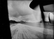 18..View of dirt runway from window of propeller plane to Manila, Busuanga Island, Philippines.