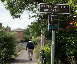 View of Water of Leith Path beside river in Leith, Scotland UK