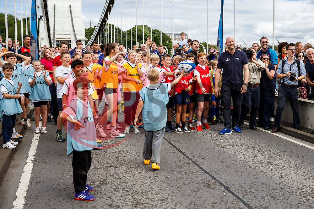 Lawrence Dallaglio attempts to kick a ball over the bridge supports and Local Junior Schools take part in activities on the iconic Clifton Suspension Bridge with Bristol Rugby Players - Mandatory byline: Rogan Thomson/JMP - 07966 386802 - 14/07/2015 - SPORT - RUGBY UNION - Bristol, England - Clifton Suspension Bridge - Webb Ellis Cup visits Bristol as part of the 2015 Rugby World Cup Trophy Tour