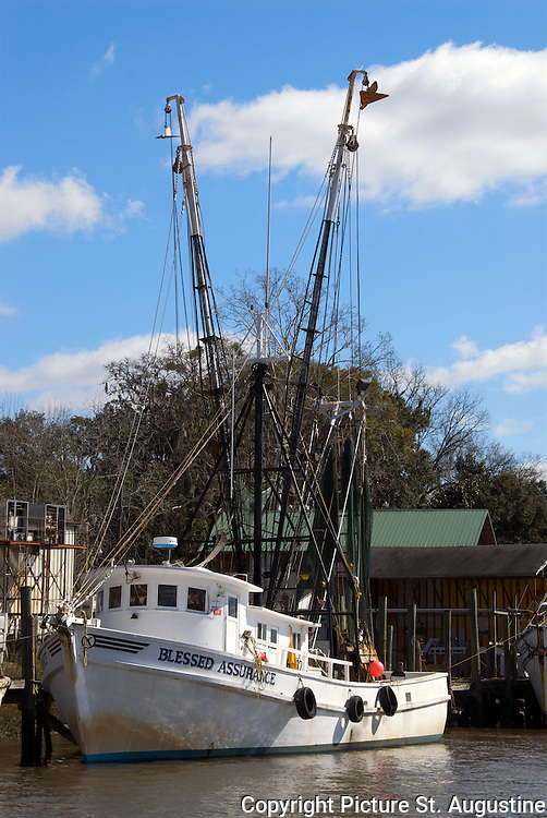 A shrimp boat rest a the dock on a sunny morning in Darien, Georgia.