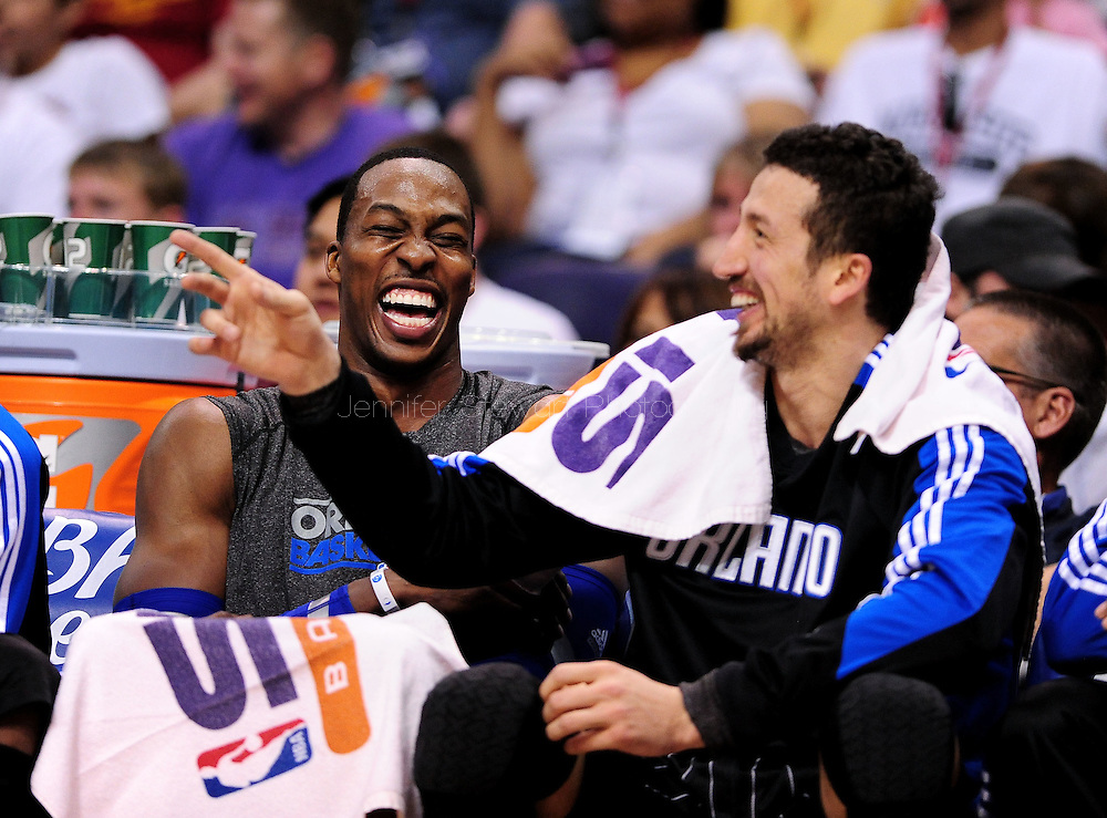 Mar. 13, 2011; Phoenix, AZ, USA; Orlando Magic center Dwight Howard (left) reacts on the bench with teammate forward Hedo Turkoglu while playing against the Phoenix Suns at the US Airways Center. The Magic defeated the Suns 111-88. Mandatory Credit: Jennifer Stewart-US PRESSWIRE