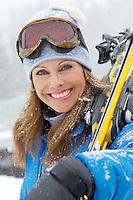 Woman with Alpine Skis