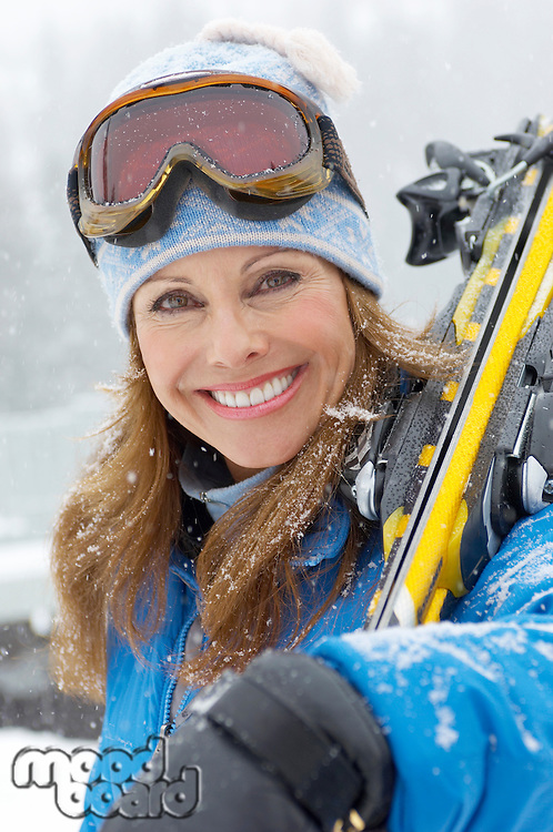 Woman with Alpine Skis