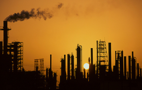 Silhouette of petrochemical refinery at sunset in Houston, Texas.