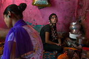 Poonam's sister Jyoti, 15, is boiling water for the family's morning tea. while on the floor of her newly built home in Oriya Basti, one of the water-contaminated colonies in Bhopal, central India, near the abandoned Union Carbide (now DOW Chemical) industrial complex, site of the infamous '1984 Gas Disaster'.