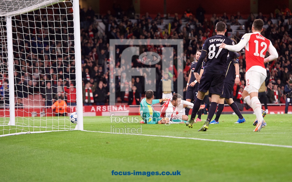 Mesut Ozil of Arsenal heads the ball past goalkeeper Eduardo of Dinamo Zagreb to score the opening goal during the UEFA Champions League match at the Emirates Stadium, London<br /> Picture by Alan Stanford/Focus Images Ltd +44 7915 056117<br /> 24/11/2015