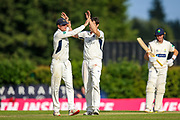 Middlesex celebrate Charlie Hemphrey of Glamorgan being dismissed LBW bowled by Tim Murtagh of Middlesex during the Specsavers County Champ Div 2 match between Middlesex County Cricket Club and Glamorgan County Cricket Club at Radlett Cricket Ground, Radlett, Herfordshire,United Kingdom on 17 June 2019.