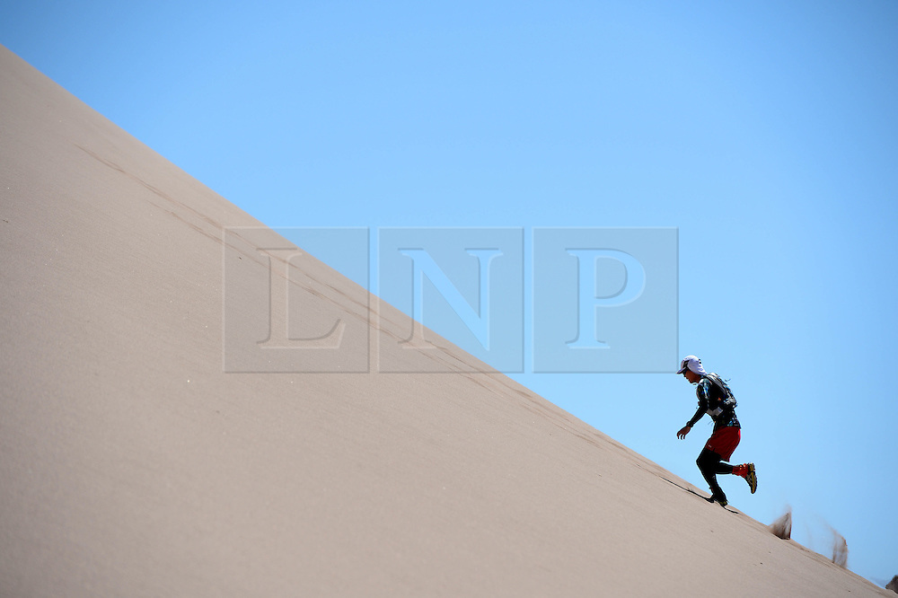 © Licensed to London News Pictures. 10/11/2014. London, England. . Photo credit : Mike King/LNP<br /> Runners train ahead of the Volcano Marathon, to be held in the Atacama Desert, Chile 11/11/2014