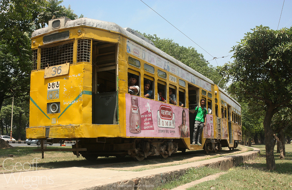 Battered SLC type tram (elephant car) of the Calcutta Tramways Company runs through Victoria Park, Kolkata, India
