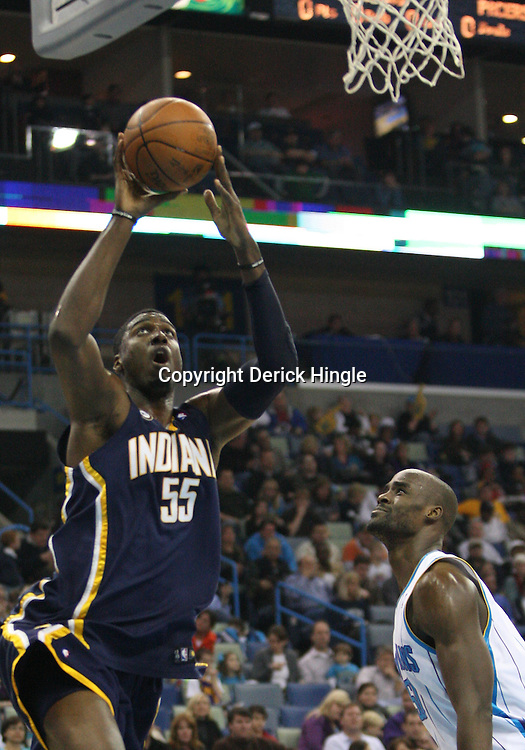 Feb 19, 2010; New Orleans, LA, USA; Indiana Pacers center Roy Hibbert (55) shoots over New Orleans Hornets center Emeka Okafor (50) during the first quarter at the New Orleans Arena. Mandatory Credit: Derick E. Hingle-US PRESSWIRE