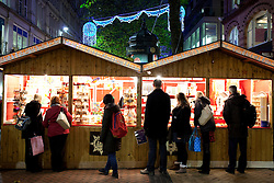 © Licensed to London News Pictures. 16/11/2012. Birmingham, UK. The largest outdoor Christmas Market in the Country has opened in Birmingham. Known as the Birmingham Frankfurt Christmas Market, this will be it's 11th year in the city. It has over 190 stalls, spreads right across the city, through both Victoria and Chamberlain Squares.  The market offers German mulled wine (Gluhwein), grilled sausages, pretzels, German beer, and for those with a sweet tooth, gingerbread, crepes and marzipan sweets. One of the many stalls doing good business. Photo credit : Dave Warren/LNP