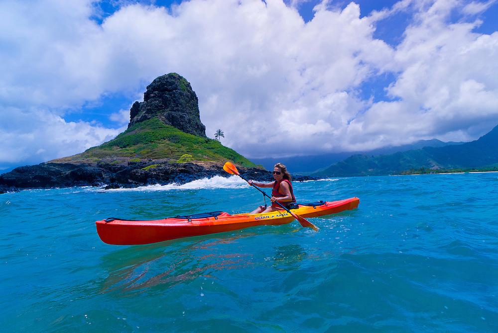 Sea kayaking, Kane'ohe Bay, Chinaman's Hat (a.k.a. Mokoli'i Island in background), Kualoa, Oahu, Hawaii, USA
